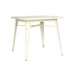 Une belle table vintage en métal peint coloris crème