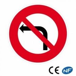 Panneau de circulation annonçant un interdit de tourner à gauche