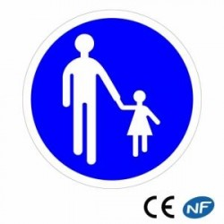 Panneau rond bleu d'obligation chemin à prendre par les piétons